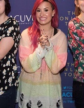 sweater,colorful,ripped,demi lovato,cute,cute sweaters,oversized sweater
