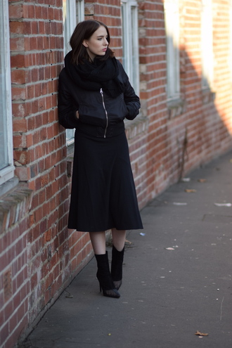 shot from the street blogger scarf winter outfits midi skirt