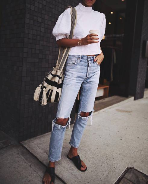 jeans tumblr blue jeans ripped jeans top white top white crop tops crop tops puffed sleeves shoes black shoes slide shoes bag bucket bag striped bag tassel outfit idea