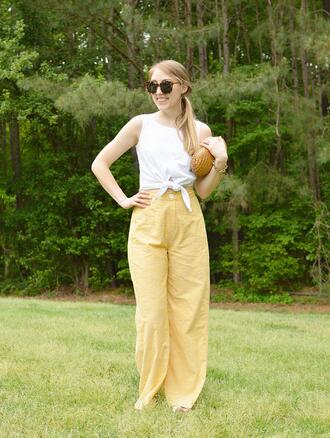 alliemjackson blogger pants tights make-up tank top yellow pants wide-leg pants tie-front top clutch summer outfits
