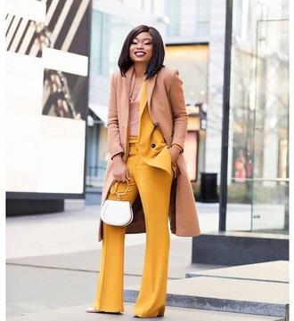 pants yellow yellow pants coat camel coat bag top camel handbag work outfits
