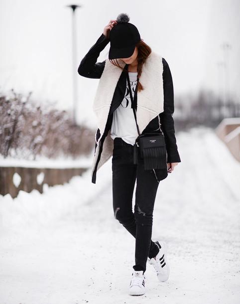 stylista blogger pom pom beanie shearling jacket adidas shoes winter jacket winter outfits hat jacket black sheepskin sheep asymmetrical wrap coat