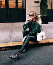 shoes,tumblr,leather pants,black pants,black leather pants,green shirt,shirt,ankle boots,embellished,buckle boots,buckles,flat boots,chelsea boots,bag,white bag,gucci,gucci bag,chain bag,sunglasses,cat eye,fall outfits