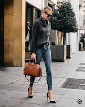 bag,handbag,leather bag,jeans,skinny jeans,high waisted jeans,pumps,high heel pumps,sweater,turtleneck sweater,sunglasses