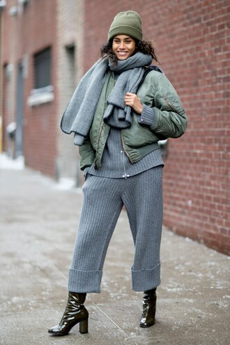 pants tumblr nyfw 2017 fashion week 2017 fashion week streetstyle culottes grey pants cropped pants knitwear knitted pants sweater grey sweater jacket army green jacket bomber jacket green bomber jacket khaki bomber jacket boots black boots high heels boots patent shoes patent boots scarf grey scarf beanie winter outfits winter look monochrome outfit grey ny fashion week 2017