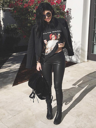 t-shirt marilyn manson rock black all black everything chic street style leather pants boots jacket bag suede glasses shades punk white red manson backpack kylie jenner streetstyle streetwear