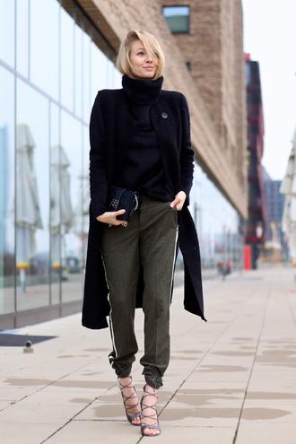 ohh couture blogger black coat strappy sandals turtleneck pants
