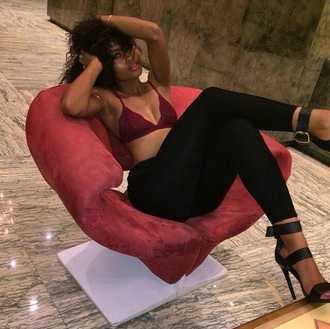 buckles three strap shoes heels bra babe brownskin black heels burgundy bralette black pants curly hair chair tumblr underwear pants jeans ruby leggings black high heels top black cute lace red