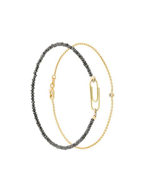 Uzerai Edits women gold black yellow jewels