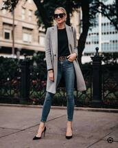 coat,wool coat,black blouse,jeans,skinny jeans,belt,pumps,high heel pumps,sunglasses,earrings