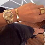 jewels,rolex,cartier ring,gold,jewelry,bracelets,stacked bracelets,gold bracelet