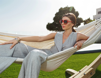 the mysterious girl blogger jewels grey jumpsuit heart sunglasses