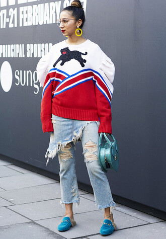 sweater london fashion week 2017 fashion week 2017 fashion week streetstyle printed sweater glasses earrings accessories accessory denim jeans blue jeans cropped jeans ripped jeans bag blue bag heart shoes blue shoes loafers gucci gucci shoes gucci princetown
