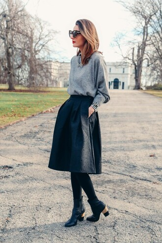 prosecco and plaid blogger black skirt grey sweater