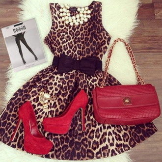 peal necklace leopard print dress red purse tights