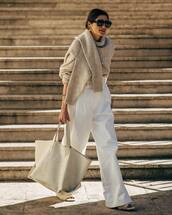 pants,white pants,wide-leg pants,high waisted pants,slide shoes,handbag,maxi bag,sweater,knitted sweater,oversized sweater,sunglasses,earrings,wool sweater