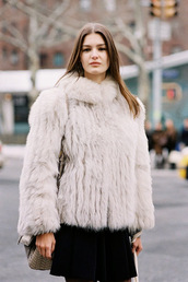 vanessa jackman,blogger,skirt,sweater,fur coat,winter outfits,coat,jacket,t-shirt,big fur coat,grey coat,streetstyle,winter look,white fur jacket