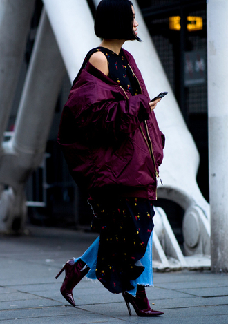 jacket tumblr burgundy burgundy jacket puffer jacket oversized jacket oversized dress asymmetrical asymmetrical dress printed dress dress over pants denim jeans blue jeans cropped jeans boots pointed boots high heels boots fashion week 2017 streetstyle
