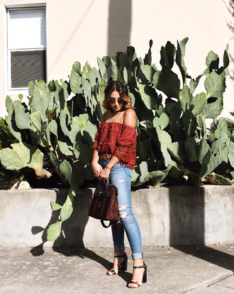 top sunglasses tumblr red top rust off the shoulder off the shoulder top denim jeans blue jeans skinny jeans ripped jeans sandals sandal heels high heel sandals bag shoes