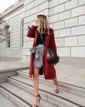 bag,shoulder bag,coat,trench coat,sandals,high heel sandals,mini skirt,wrap skirt,black blouse,aviator sunglasses