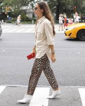 pants,wide-leg pants,leopard print,booties,white boots,watch,shirt,oversized shirt,earrings,retro sunglasses