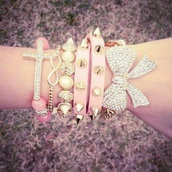 jewels,pink,bracelets,diamonds,diamons,spike,bow,cross,infinity,gold,silver,noeud,croix,spikes,spiked bracelet,stacked bracelets,statches,bun chain,cute,jewelry,hand jewelry,accessories,arm candy,arm party,pretty,bling,tumblr,just girly stuff,girly,girl,Accessory,studs,pastel,chain bracelet,back to school,rose