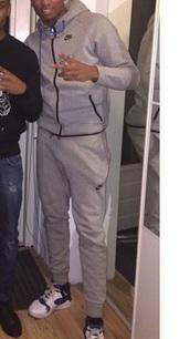 jumpsuit,grey sweater,grey sweatpants,grey top,grey hoodie,grey jacket,nike sweater,nike jacket,nike sweatshirt,nike air