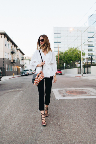 le fashion image blogger sunglasses top blouse jeans black jeans cropped jeans cropped bootcut jeans cropped bootcut black jeans wrap dress wrap top black bag long sleeves sandals strappy sandals fall outfits sandal heels high heel sandals black sandals kimono