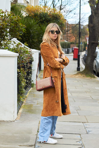 coat brown coat jeans trainers bag sunglasses white shoes