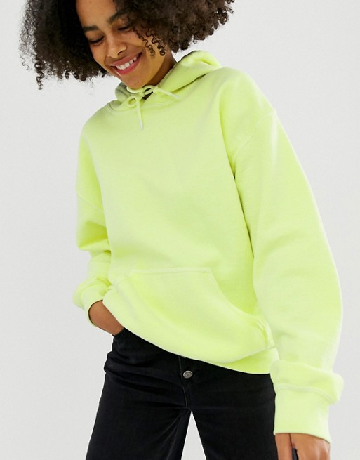 Reclaimed Vintage inspired overdye hoodie in bright yellow at asos.com