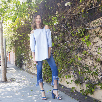louise roe blogger jeans shoes jewels off the shoulder denim top fringes frayed denim long sleeves thick heel blue heels summer outfits frayed jeans puffed sleeves