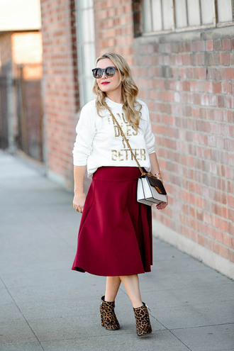thehuntercollector blogger skirt sweater shoes bag jewels fall outfits white sweater ankle boots midi skirt animal print ankle boots