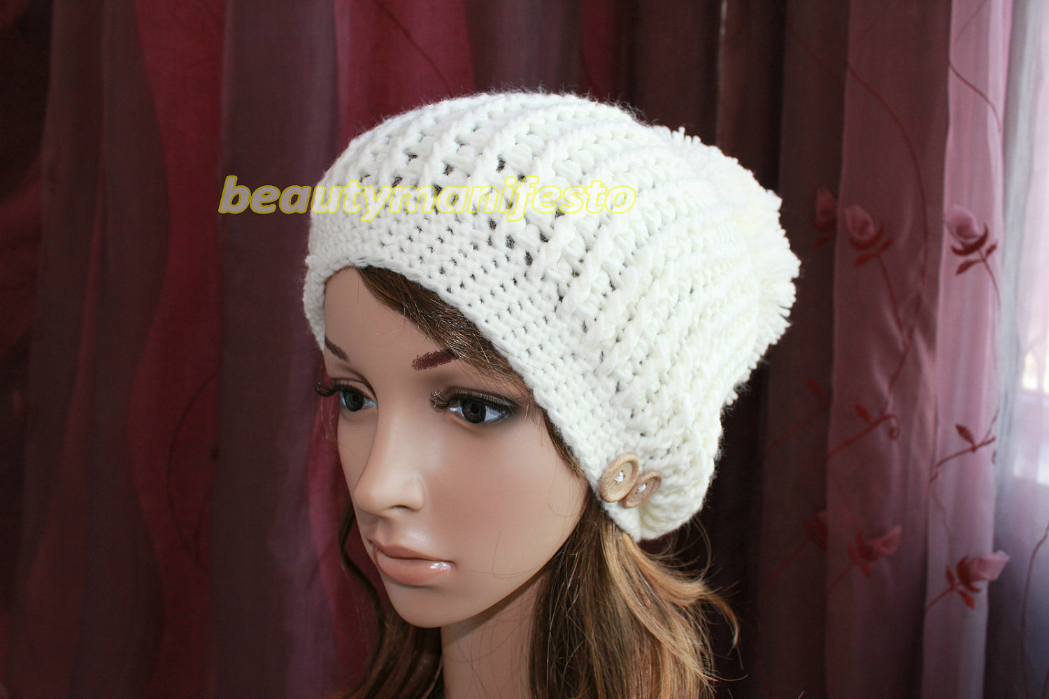 Pom pom hat in white hand crocheted
