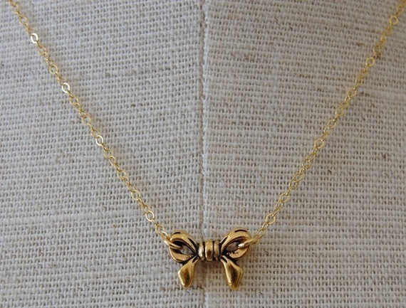 Tiny gold bow necklace by verabel on etsy