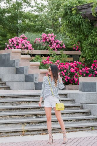 the material girl blogger sunglasses shoes bag button up striped top long sleeves white shorts yellow bag thick hee thick heel lace up lace up heels summer outfits