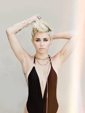 swimwear,miley cyrus,sexy black swimsuit,black swimwear,gold jewelry,jewels