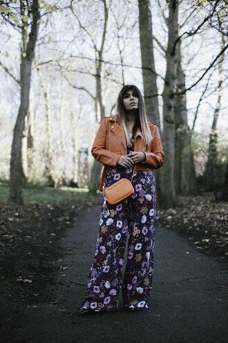 she wears fashion blogger jumpsuit shoes bag red jacket cropped leather jacket cropped jacket floral jumpsuit crossbody bag