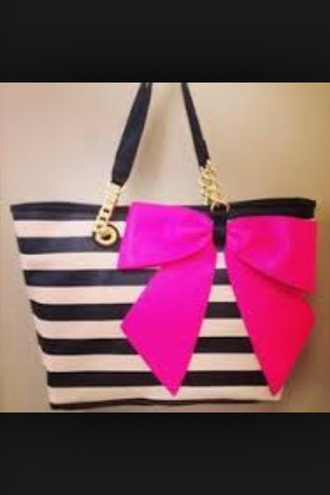 bag black and white strips on the bag with pink bow