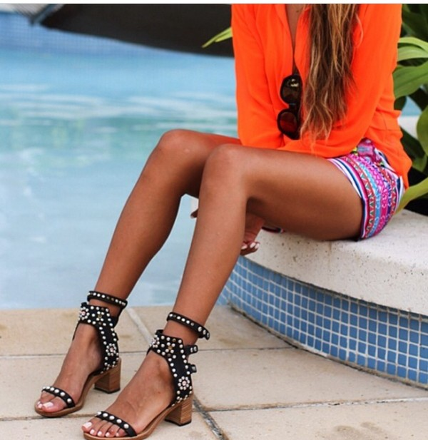 shorts aztec shorts color/pattern summer outfits cute shorts stripes neon blouse orange blouse summer tanned girl blonde hair sunglasses high heels black pool