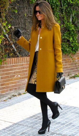 coat mustard coat gold skirt black tights blogger black heels