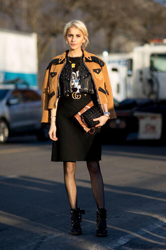 jacket nyfw 2017 fashion week 2017 fashion week streetstyle brown jacket skirt black skirt midi skirt gucci gucci belt top black top fringes boots black boots ankle boots lace up boots tights net tights fishnet tights