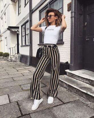 pants stripes white wide leg pants white top sneakers white sneakers bag sunglasses