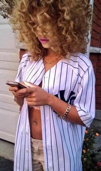 shirt jersey baseball stripes curly hair fashion gold white khaki black oversized baseball jersey new york yankees belly button ring necklace pants bustier bracelets lipstick pink lipstick pink shorts underwear basketball jersey