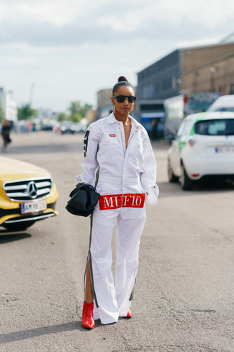 jumpsuit overalls copenhagen fashion week streetstyle white jumpsuit dungarees boots red boots ankle boots bag sunglasses