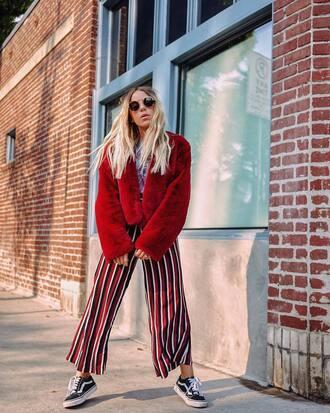 jacket tumblr red jacket fur jacket pants wide-leg pants stripes striped pants sneakers black sneakers sunglasses