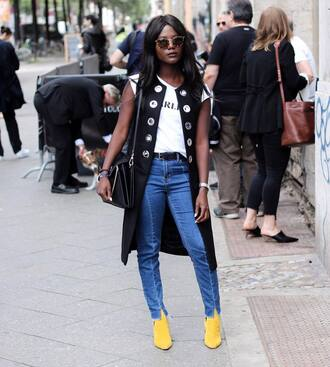 coat tumblr vest black vest t-shirt white t-shirt denim jeans blue jeans shoes boots yellow bag black bag sunglasses