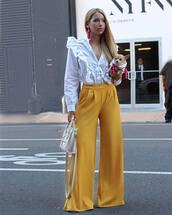 pants,yellow,yellow pants,wide-leg pants,shirt,white shirt,ruffle,ruffle shirt,bag,white bag,earrings