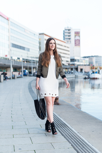 andy sparkles blogger jacket dress bag jewels shoes mini dress bomber jacket green bomber jacket peep toe boots ankle boots black bag spring outfits white dress