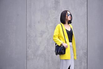 shiny sil blogger yellow coat black tank top minimalist