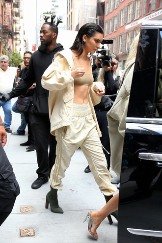 pants khaki boots tumblr kendall jenner celebrity style celebrity model model off-duty sweatpants nude pants jacket nude jacket adidas adidas pants adidas sweatpants adidas jacket top crop tops boots high heels boots yeezy